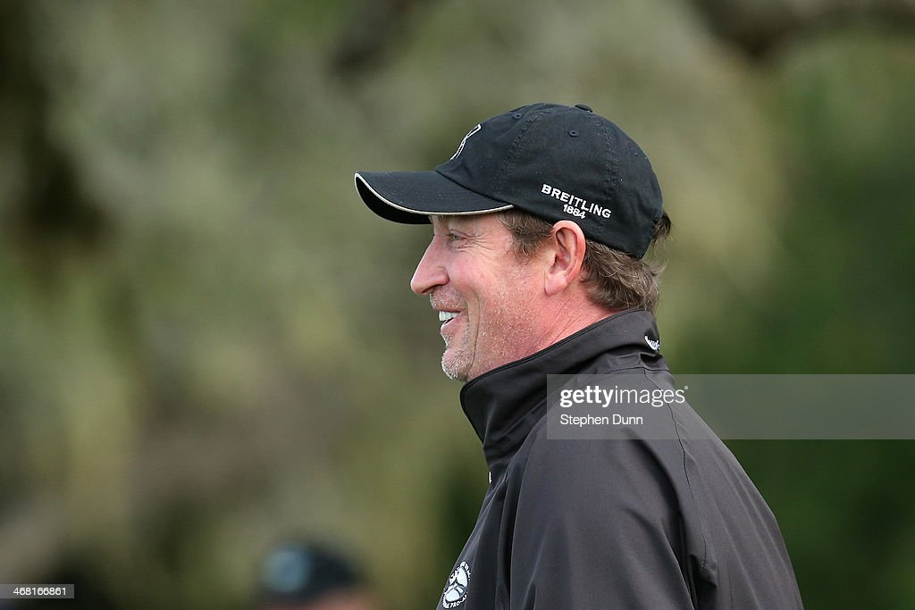 Former professional hockey player Wayne Gretzky looks on during the third round of the AT&T Pebble Beach National Pro-Am at the Pebble Beach Golf Links on February 8, 2014 in Pebble Beach, California.