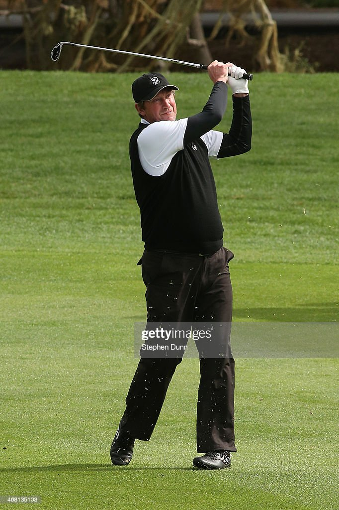 Former professional hockey player Wayne Gretzky plays a fairway shot on the third hole during the final round of the AT&T Pebble Beach National Pro-Am at the Pebble Beach Golf Links on February 9, 2014 in Pebble Beach, California.
