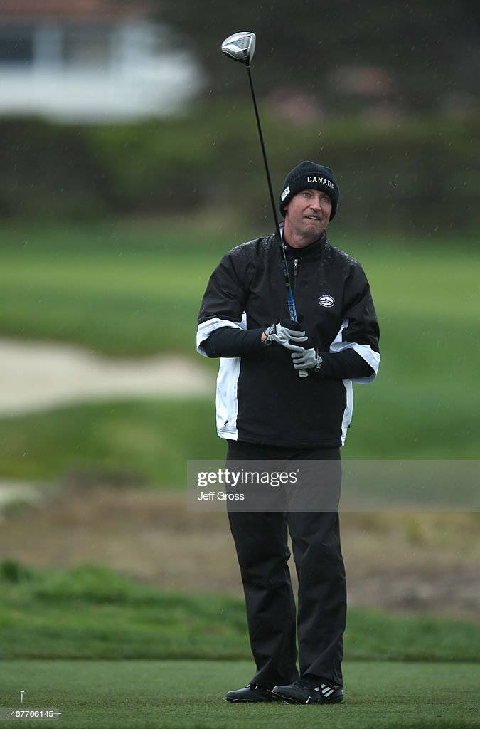 Former professional hockey player Wayne Gretzky plays a shot during the second round of the AT&T Pebble Beach National Pro-Am at the Monterey Peninsula Country Club on February 7, 2014 in Pebble Beach, California.