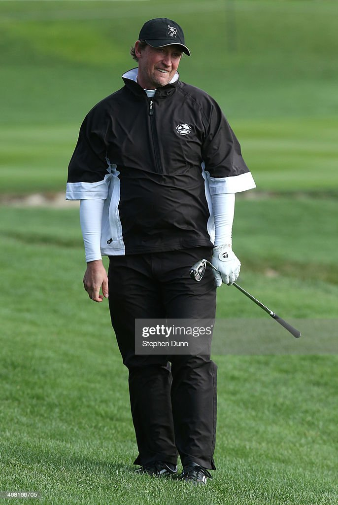 Former professional hockey player Wayne Gretzky watches his approach shot on the third hole during the third round of the AT&T Pebble Beach National Pro-Am at the Pebble Beach Golf Links on February 8, 2014 in Pebble Beach, California.