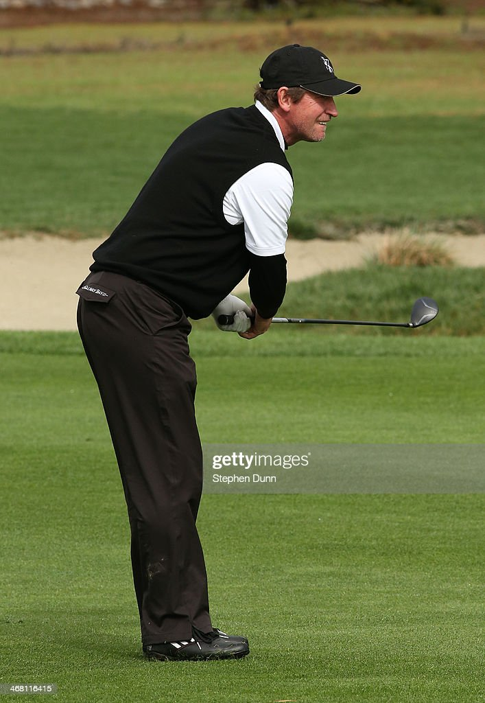 Former professional hockey player Wayne Gretzky watches his second shot on the second hole during the final round of the AT&T Pebble Beach National Pro-Am at the Pebble Beach Golf Links on February 9, 2014 in Pebble Beach, California.