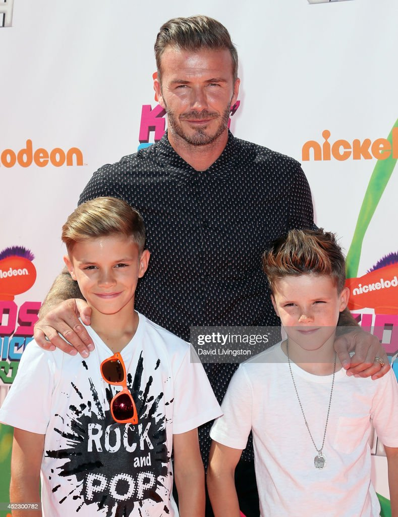 Former professional soccer player <a gi-track='captionPersonalityLinkClicked' href=/galleries/search?phrase=David+Beckham&family=editorial&specificpeople=158480 ng-click='$event.stopPropagation()'>David Beckham</a> (C) and children Romeo James Beckham (L) and Cruz <a gi-track='captionPersonalityLinkClicked' href=/galleries/search?phrase=David+Beckham&family=editorial&specificpeople=158480 ng-click='$event.stopPropagation()'>David Beckham</a> attend the Nickelodeon Kids' Choice Sports Awards 2014 at Pauley Pavilion on July 17, 2014 in Los Angeles, California.