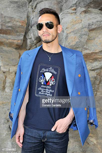 Former professional soccer player Hidetoshi Nakata attends the Louis Vuitton Cruise 2016 Resort Collection shown at a private residence on May 6 2015...