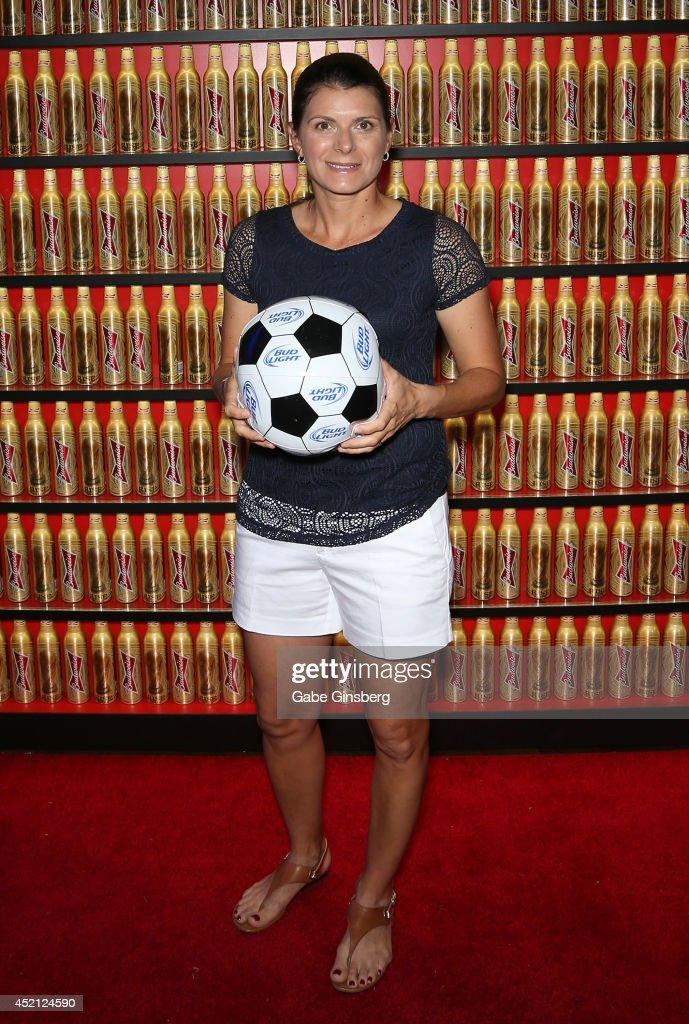 Former professional soccer player <a gi-track='captionPersonalityLinkClicked' href=/galleries/search?phrase=Mia+Hamm&family=editorial&specificpeople=203156 ng-click='$event.stopPropagation()'>Mia Hamm</a> poses with a Bud Light soccer ball as she arrives at FIFA World Cup Finals Bud Light and Budweiser VIP Party at the Palms Casino Resort on July 13, 2014 in Las Vegas, Nevada.