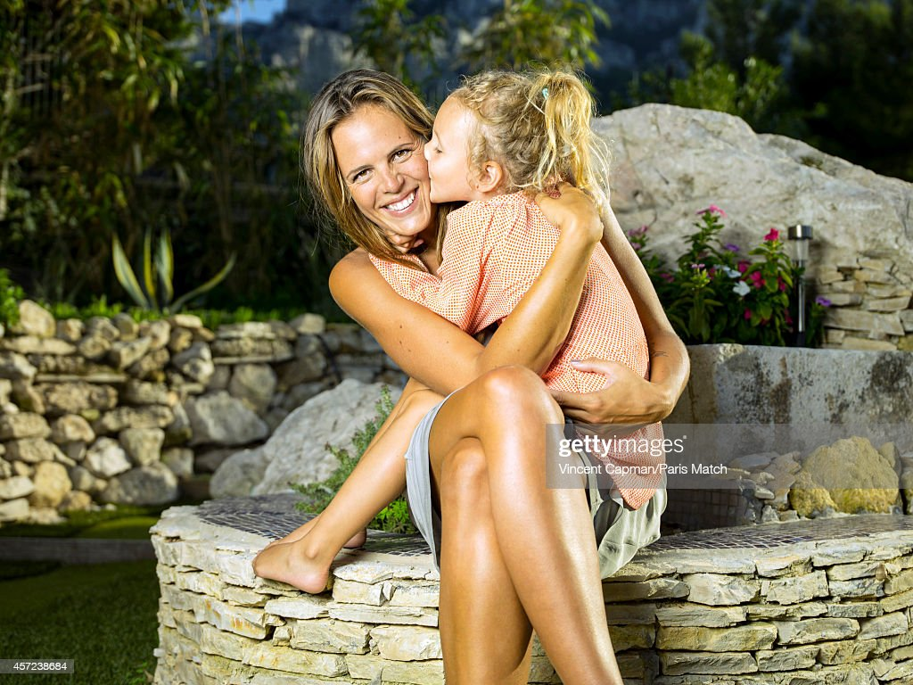 Former professional swimmer <a gi-track='captionPersonalityLinkClicked' href=/galleries/search?phrase=Laure+Manaudou&family=editorial&specificpeople=596425 ng-click='$event.stopPropagation()'>Laure Manaudou</a> is photographed at home with her daughter Manon Bousquet for Paris Match on October 3, 2014 in Marseille, France.