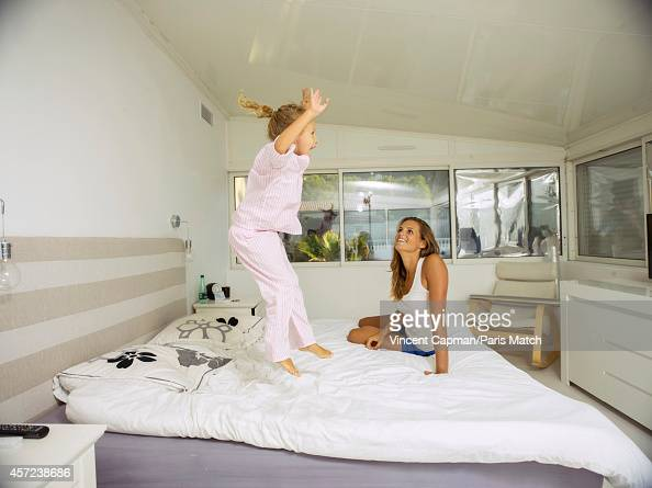 Former professional swimmer Laure Manaudou is photographed at home with her daughter Manon Bousquet for Paris Match on October 3 2014 in Marseille...
