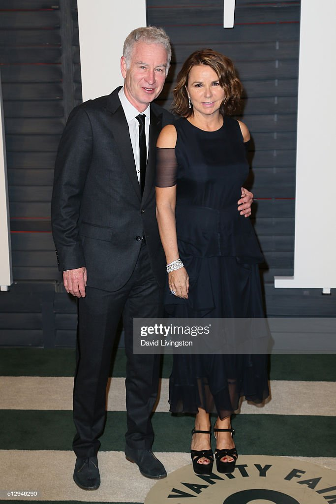 Former professional tennis player John McEnroe and singer Patty Smyth arrive at the 2016 Vanity Fair Oscar Party Hosted by Graydon Carter at the Wallis Annenberg Center for the Performing Arts on February 28, 2016 in Beverly Hills, California.