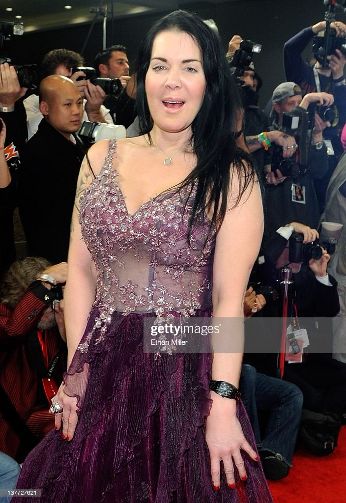 Former professional wrestler and adult film actress Chyna arrives at the 29th annual Adult Video News Awards Show at the Hard Rock Hotel & Casino January 21, 2012 in Las Vegas, Nevada.