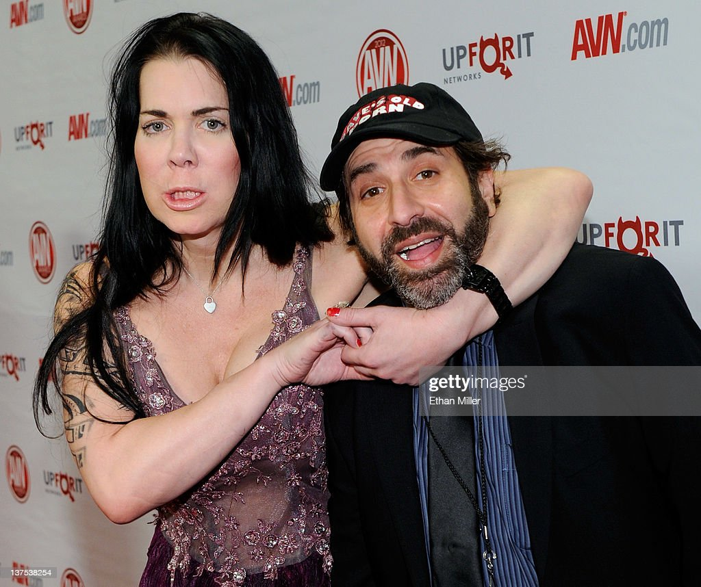 Former professional wrestler and adult film actress Chyna (L) jokes around with comedian and show co-host <a gi-track='captionPersonalityLinkClicked' href=/galleries/search?phrase=Dave+Attell&family=editorial&specificpeople=2325776 ng-click='$event.stopPropagation()'>Dave Attell</a> as they arrive at the 29th annual Adult Video News Awards Show at the Hard Rock Hotel & Casino January 21, 2012 in Las Vegas, Nevada.