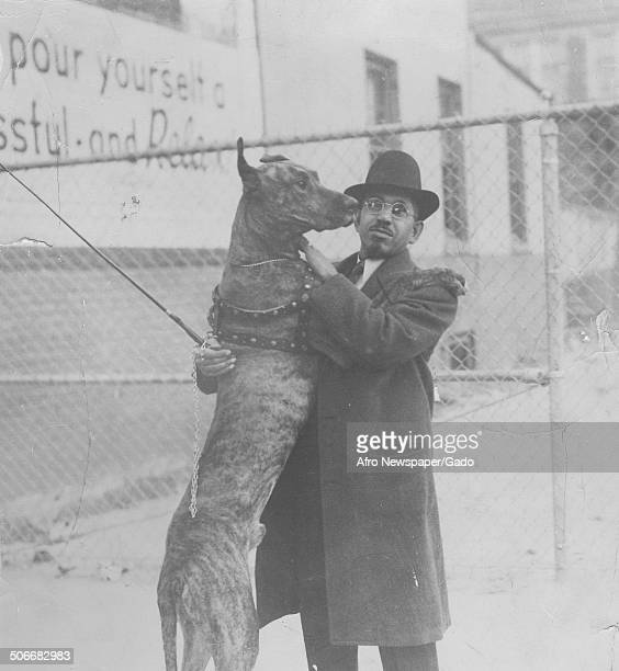 Former publisher of the Afro American Newspapers John H Murphy Jr and a show dog 1941