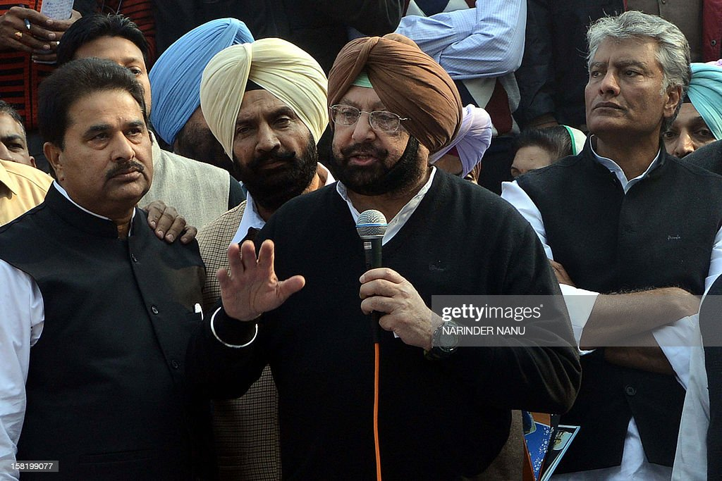 Former Punjab state chief minister Capt Amarinder Singh, (2R) with Congress Legislature Party (CLP) leader Sunil Jakhar (R) and Congress leaders, speaks during a protest against Punjab's ruling Shiromani Akali Dal (SAD) in Amritsar on December 11, 2012. The demonstration was held in protest against the 'deteriorating' law and order situation in the state and the murder of Punjab Police Assistant Sub-Inspector (ASI ) Ravinder Pal Singh. The leader of Punjab's ruling Shiromani Akali Dal and an accomplice were arrested on December 6, 2012, for allegedly killing the police official Ravinder Pal Singh.