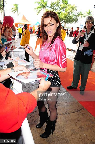 Former Pussycat Doll Jessica Sutta arrives on the orange carpet for the Dolphins vs Lions game at Sun Life Stadium on December 26 2010 in Miami...