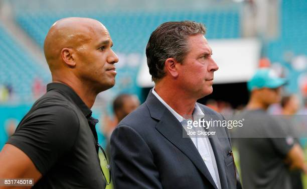 Former quarterback Dan Marino right of the Miami Dolphins speaks with Jason Taylor also a former Dolphins player before the team met the Atlanta...