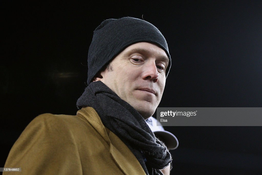 Former quarterback <a gi-track='captionPersonalityLinkClicked' href=/galleries/search?phrase=Drew+Bledsoe&family=editorial&specificpeople=183356 ng-click='$event.stopPropagation()'>Drew Bledsoe</a> of the New England Patriots walks on the field after the AFC Championship Game at Gillette Stadium on January 22, 2012 in Foxboro, Massachusetts. The New England Patriots defeated the Baltimore Ravens 20-23.