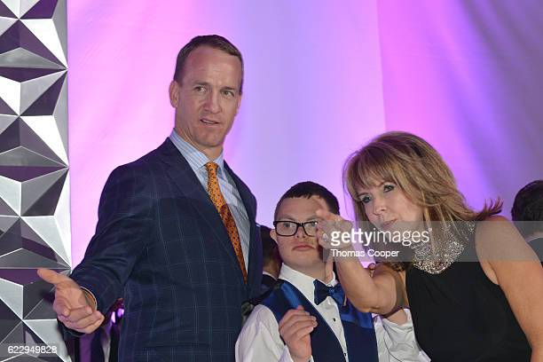 Former quarterback of the Denver Broncos Peyton Manning Louie Rotella and 9News anchor and Emcee of the event Kim Christiansen at the Global Down...