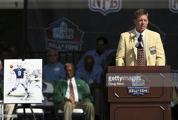Former quarterback Troy Aikman of the Dallas Cowboys speaks while being inducted during the Class of 2006 Pro Football Hall of Fame Enshrinement...