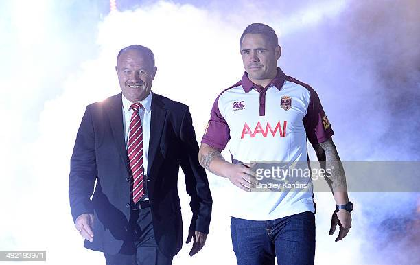 Former Queensland Origin great a Rugby League Immortal Wally Lewis walks out together with current player Corey Parker during the Queensland Maroons...