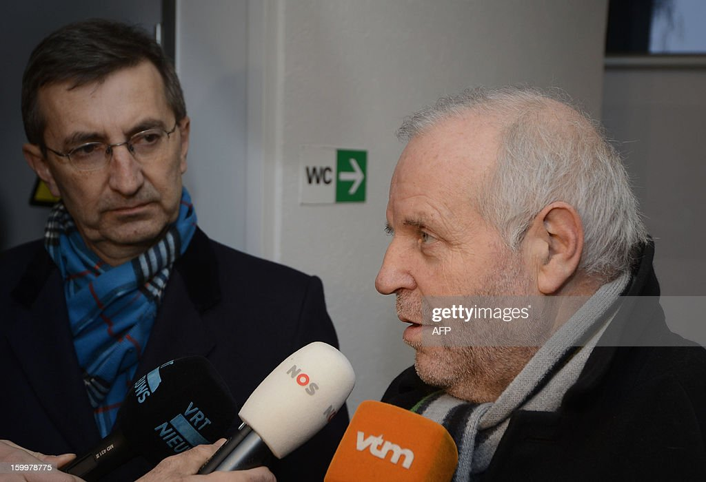 Former Rabobank team doctor Geert Leinders (L) looks at his lawyer Johnny Maeschalck who speaks to journalists after a hearing of the Belgian Royal Cycling Association in Brussels, on January 24, 2013. Rabobank, which has sponsored a professional cycling team for the last 17 years, announced last October that it would sever its ties with the team from December 31, claiming the sport had been irrevocably damaged by a succession of doping cases, notably the devastating Lance Armstrong affair. From January 1, 2013, the team rideS under the banner of Blanco Pro Cycling. Armstrong had already been stripped of his seven Tour de France titles and his 2000 Olympic bronze medal before making his personal confession to American talk show host Oprah Winfrey last week. AFP PHOTO BELGA DIRK WAEM