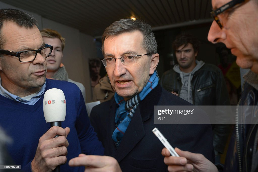 Former Rabobank team doctor Geert Leinders speaks to journalists after a hearing of the Belgian Royal Cycling Association in Brussels, on January 24, 2013. Rabobank, which has sponsored a professional cycling team for the last 17 years, announced last October that it would sever its ties with the team from December 31, claiming the sport had been irrevocably damaged by a succession of doping cases, notably the devastating Lance Armstrong affair. From January 1, 2013, the team rideS under the banner of Blanco Pro Cycling. Armstrong had already been stripped of his seven Tour de France titles and his 2000 Olympic bronze medal before making his personal confession to American talk show host Oprah Winfrey last week.