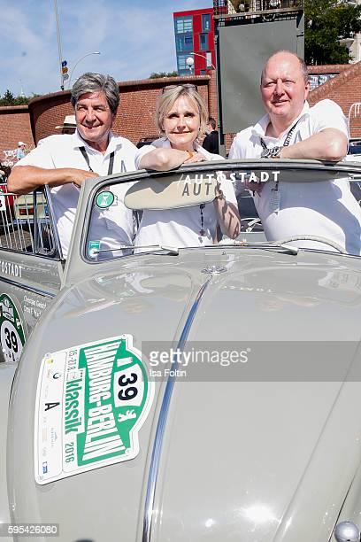 Former race driver Christian Geistdoerfer german actress Katharina Schubert and Otto Ferdinand Wachs CEO Autostadt GmbH attend the first day of the...