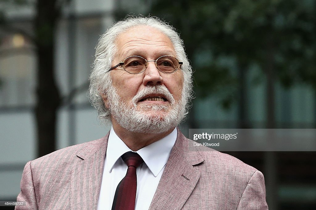 Former radio and TV presenter <a gi-track='captionPersonalityLinkClicked' href=/galleries/search?phrase=Dave+Lee+Travis&family=editorial&specificpeople=1624287 ng-click='$event.stopPropagation()'>Dave Lee Travis</a>, real name David Patrick Griffin, arrives at Southwark Crown Court for a re-trial on September 1, 2014 in London, England. After being cleared of 12 counts of indecent assault in February Travis now faces a retrial on two charges and a new count of indecent assault.