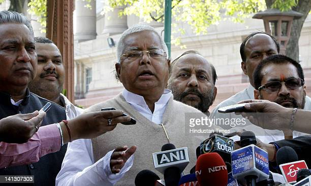 Former Rail Minister Lalu Prasad Yadav addresses the media outside parliament after attending the rail budget 201213 presentation by the Railway...
