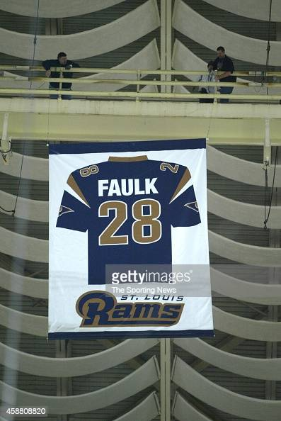 Former Rams player Marshall Faulk is honored before a game against the Pittsburgh Steelers on December 20 2007 at the Edward Jones Dome in St Louis...