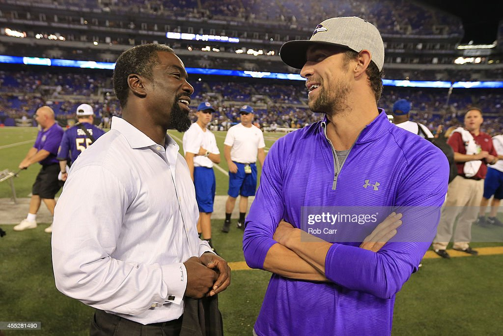 Former Ravens player <a gi-track='captionPersonalityLinkClicked' href=/galleries/search?phrase=Ed+Reed&family=editorial&specificpeople=194933 ng-click='$event.stopPropagation()'>Ed Reed</a> talks with Olympian <a gi-track='captionPersonalityLinkClicked' href=/galleries/search?phrase=Michael+Phelps&family=editorial&specificpeople=162698 ng-click='$event.stopPropagation()'>Michael Phelps</a> before the game between the Baltimore Ravens and the Pittsburgh Steelers at M&T Bank Stadium on September 11, 2014 in Baltimore, Maryland.