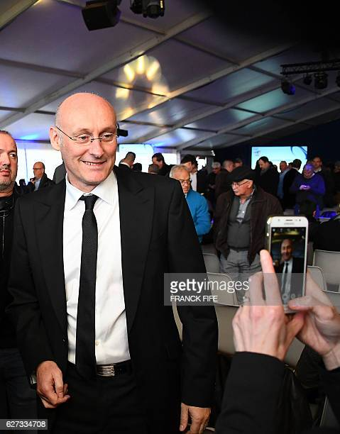 Former RC Toulon's head coach and candidate for the presidency of the French Rugby Federation Bernard Laporte poses for photographs ahead of the...