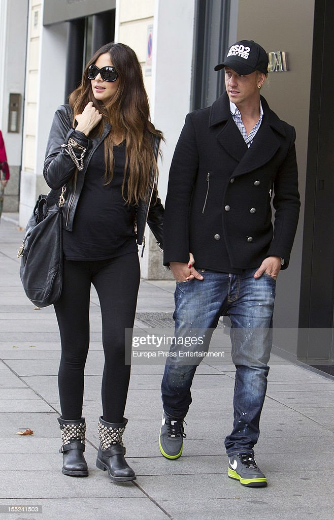 Former Real Madrid football player Guti (L) and his girlfriend <a gi-track='captionPersonalityLinkClicked' href=/galleries/search?phrase=Romina+Belluscio&family=editorial&specificpeople=7312719 ng-click='$event.stopPropagation()'>Romina Belluscio</a> are seen on November 2, 2012 in Madrid, Spain.