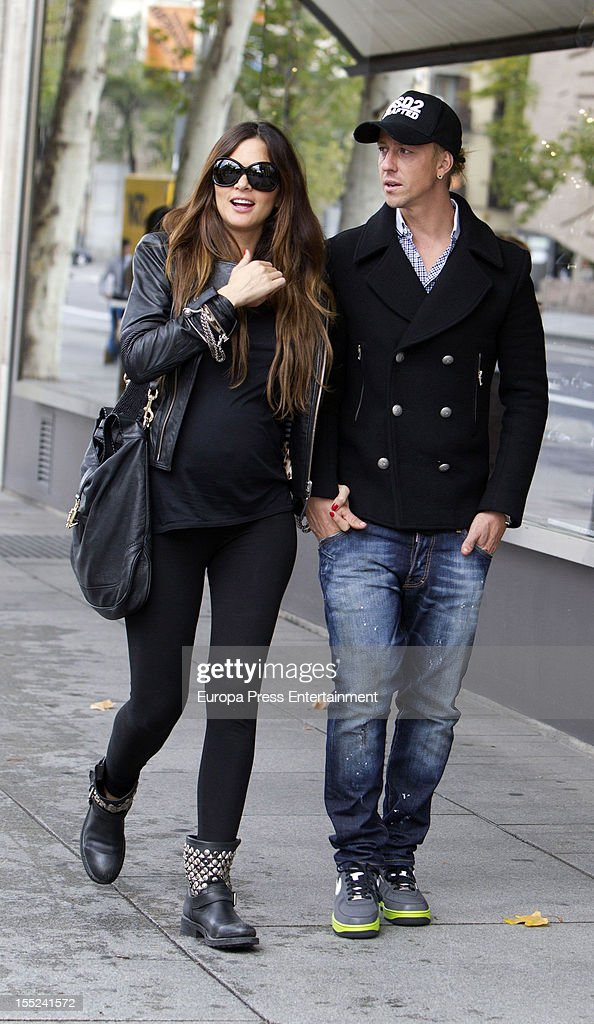Former Real Madrid football player Guti (R) and his girlfriend <a gi-track='captionPersonalityLinkClicked' href=/galleries/search?phrase=Romina+Belluscio&family=editorial&specificpeople=7312719 ng-click='$event.stopPropagation()'>Romina Belluscio</a> are seen on November 2, 2012 in Madrid, Spain.