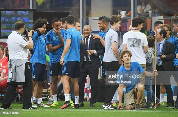 Former Real Madrid player Roberto Carlos is great by current squad prior to a Real Madrid training session on the eve of the UEFA Champions League...