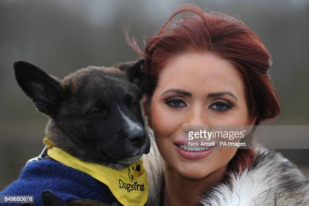 Former reality television personality Amy Childs with rescue dog Basil during the 'first dig' at the new Dogs Trust Essex Rehoming Centre Nevendon...