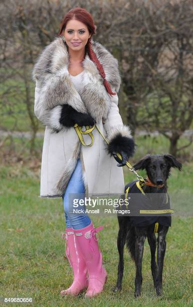 Former reality television personality Amy Childs with rescue dog Lionel the Lurcher during the 'first dig' at the new Dogs Trust Essex Rehoming...