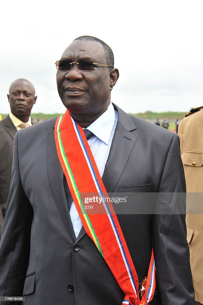 Former rebel leader <a gi-track='captionPersonalityLinkClicked' href=/galleries/search?phrase=Michel+Djotodia&family=editorial&specificpeople=10107290 ng-click='$event.stopPropagation()'>Michel Djotodia</a> stands during a swearing-in ceremony on August 18, 2013 in Bangui. Former rebel leader <a gi-track='captionPersonalityLinkClicked' href=/galleries/search?phrase=Michel+Djotodia&family=editorial&specificpeople=10107290 ng-click='$event.stopPropagation()'>Michel Djotodia</a> was sworn in as president of the Central African Republic on August 18, five months after seizing power in the violence-wracked country. The former French colony's sixth president is tasked with restoring security in the impoverished state and steering the nation through a transition period leading to fresh polls within 18 months. STRINGER