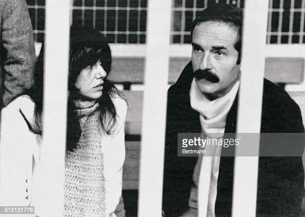 Former Red Brigades terrorists Adriana Faranda and Valerio Morucci are shown behind steel bars in a Rome courtroom here during an appeal trial...