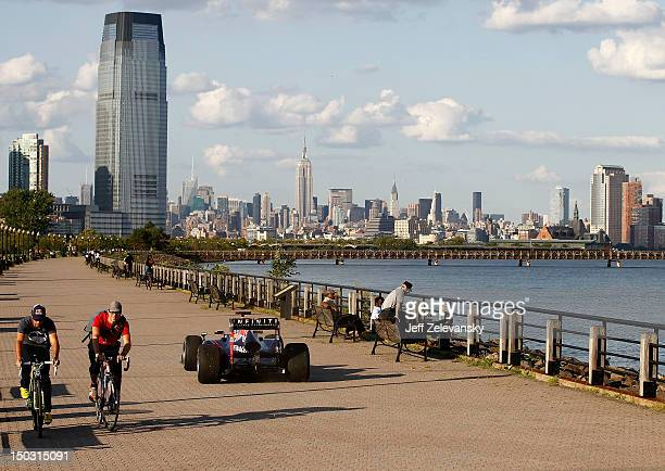 Former Red Bull Racing Formula 1 driver David Coulthard drives the Red Bull running show car through Liberty State Park for a video shoot on August...