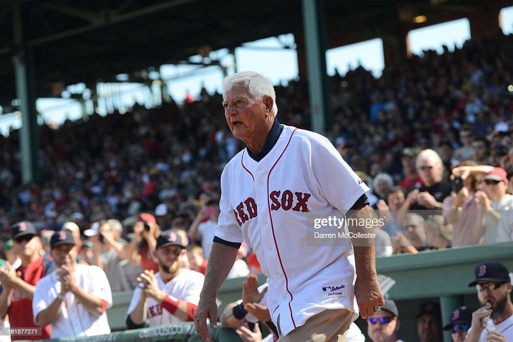 Former Red Sox great and Hall-of-Famer <a gi-track='captionPersonalityLinkClicked' href=/galleries/search?phrase=Carl+Yastrzemski&family=editorial&specificpeople=1001959 ng-click='$event.stopPropagation()'>Carl Yastrzemski</a> takes the field to throw out the first pitch prior to the Red Sox game against the Toronto Blue Jays at Fenway Park on September 22, 2013 in Boston, Massachusetts. Yastrzemski was honored earlier in day with a statue.