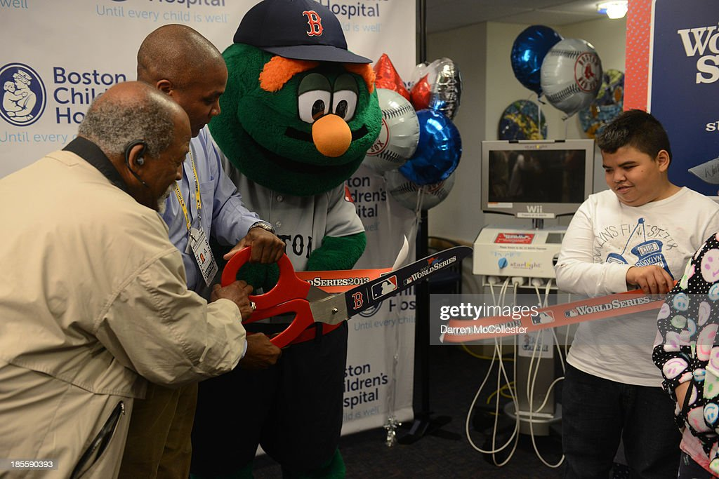Former Red Sox great Luis Tiant (L), Wally, MLB, and Boston Red Sox celebrate World Series with Boston Children's Hospital Starlight Fun Center Donation at Boston Children's Hospital on October 22, 2013 in Boston, Massachusetts.