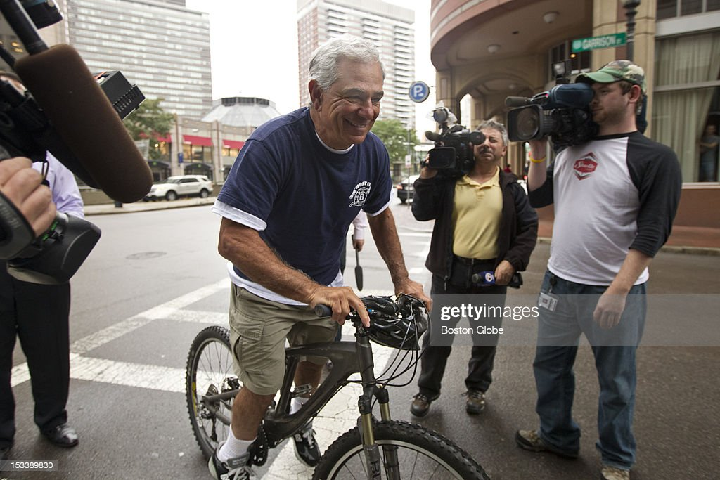 Former Red Sox manager Bobby Valentine talks to the media after his bike ride outside his residence at the Colonnade Residences on Thursday October 4, 2012.