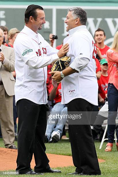 Former Red Sox pitcher Tim Wakefield is greeted by former teammate Doug Mirabelli before the game against the Seattle Mariners on May 15 2012 at...