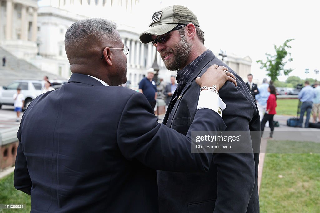 Former Rep. Allen West (R-FL) (L) embraces former Navy SEAL Benjamin Smith before a news conference organized by Special Operations Speaks Out (SOS) Political Action Committee at the U.S. Capitol July 23, 2013 in Washington, DC. Members of SOS unrolled a 60-foot-long scroll bearing the names of more than 1,000 Special Service veterans demanding a full investigation of the September 11, 2012, Benghazi attacks.