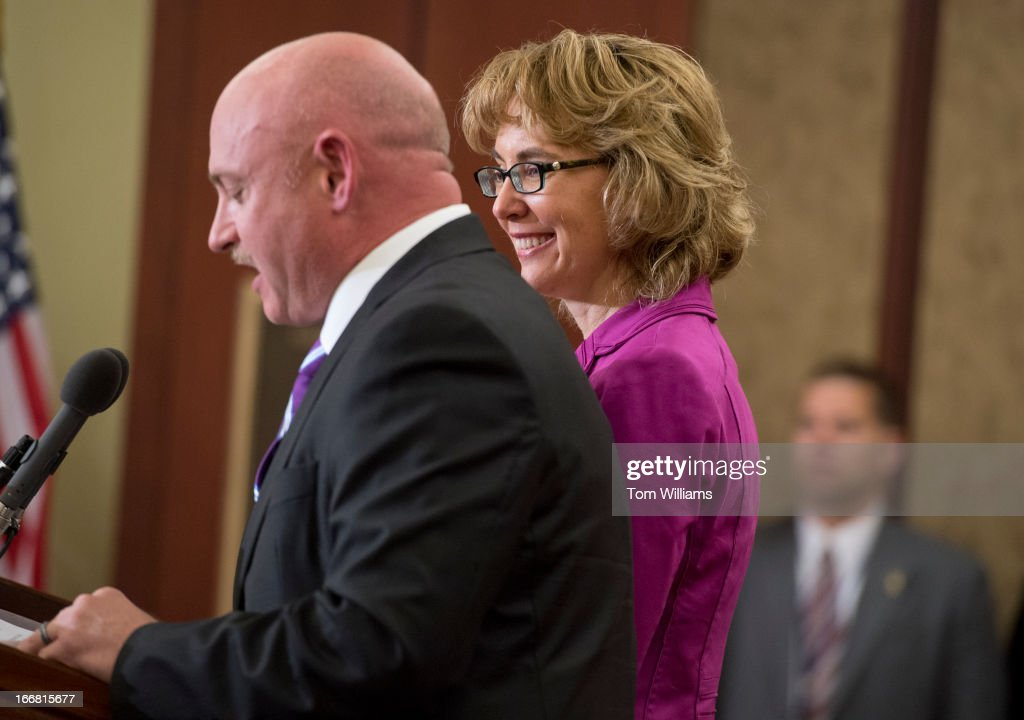 Former Rep. Gabrielle Giffords, D-Ariz., and her husband Mark Kelly, attend a ceremony to dedicate the Gabe Zimmerman Meeting Room in the Capitol Visitor Center. Zimmerman was a Giffords staffer who was killed in the 2011 Tucson shootings that injured Giffords.