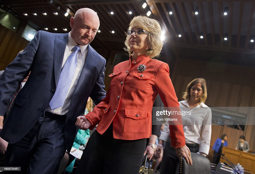 Former Rep. Gabrielle Giffords, D-Ariz., and her husband Mark Kelly leave the witness table after Giffords testified on gun violence during a Senate Judiciary Committee hearing in Hart Building entitled 'What Should America Do About Gun Violence?' Giffords was severely wounded during a mass shooting in Tucson, Ariz., in 2011.