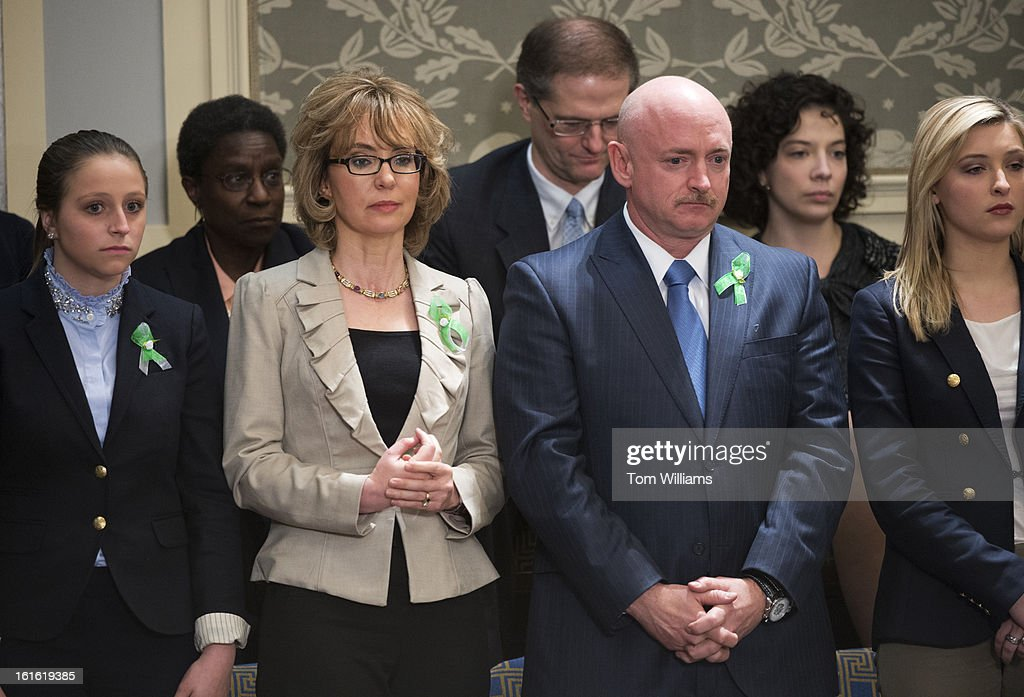 Former Rep. Gabrielle Giffords, D-Ariz., and her husband Mark Kelly listen to President Barack Obama deliver his State of the Union address to Congress in the House chamber.
