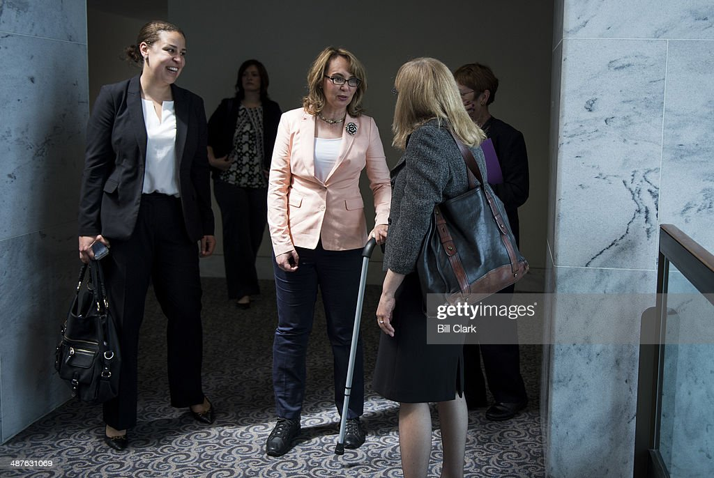 Former Rep. Gabrielle Giffords, D-Ariz., arrives on the 7th floor of the Hart Senate Office Building for her meeting with Sen. Richard Blumenthal, D-Conn., and Sen. Chris Murphy, D-Conn., to discuss Congressional efforts to curb gun violence and domestic violence on May 1, 2014.