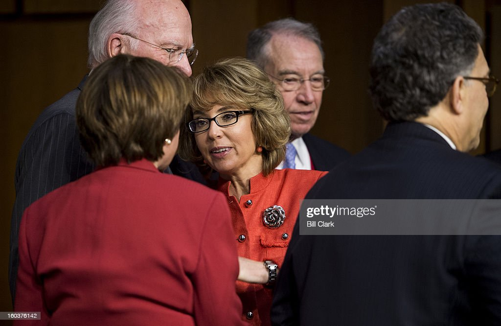 Former Rep. Gabrielle Giffords, D-Ariz., center, is greeted by Senators as she arrives to testify the Senate Judiciary Committee hearing on 'What Should America Do About Gun Violence?' on Wednesday, Jan. 30, 2013. From left around Giffords are Sens. Patrick Leahy, D-Vt., Amy Klobuchar, D-Minn., Chuck Grassley, R-Iowa, and Al Franken, D-Minn.