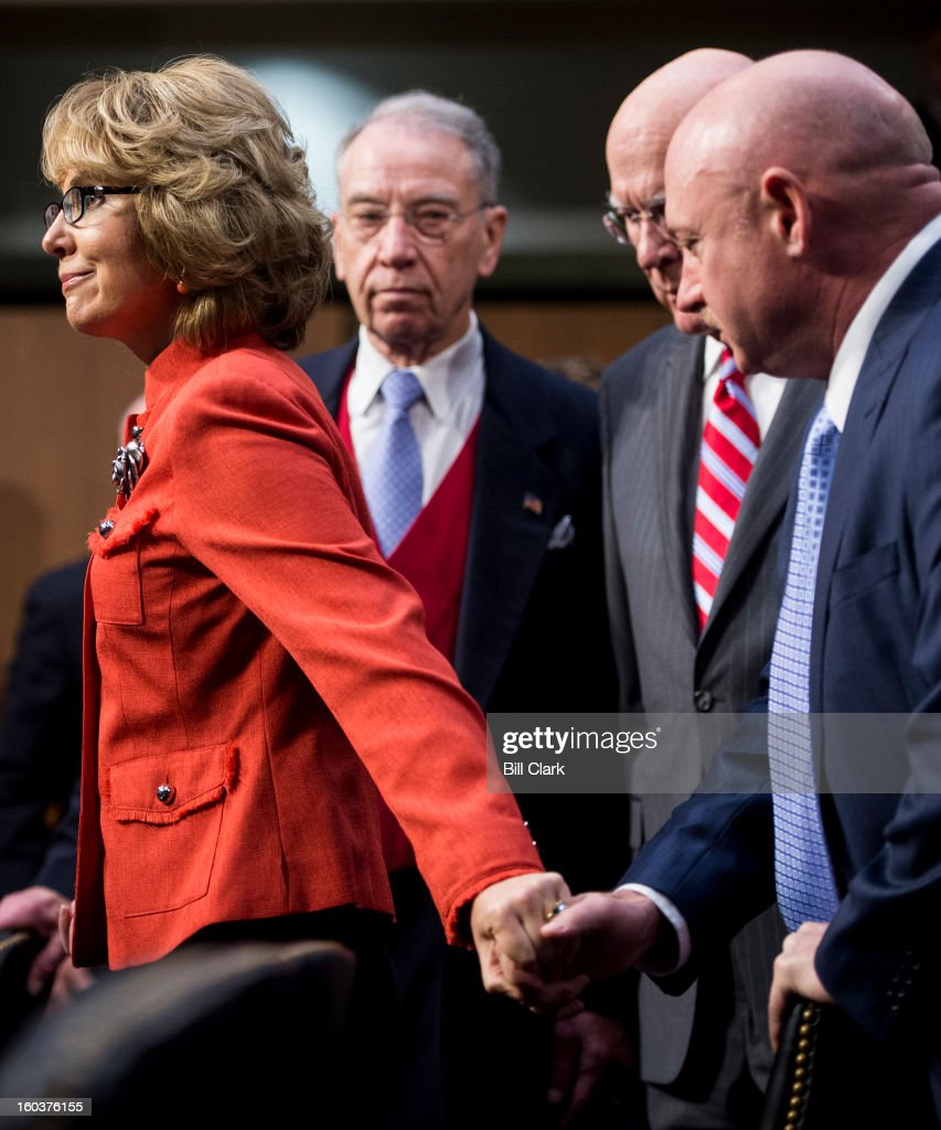 Former Rep. Gabrielle Giffords, D-Ariz., is escorted to her seat by, from left, Sen. Chuck Grassley, R-Iowa, Sen. Patrick Leahy, D-Vt., and her husband Retired Navy Capt. Mark Kelly during the Senate Judiciary Committee hearing on 'What Should America Do About Gun Violence?' on Wednesday, Jan. 30, 2013.
