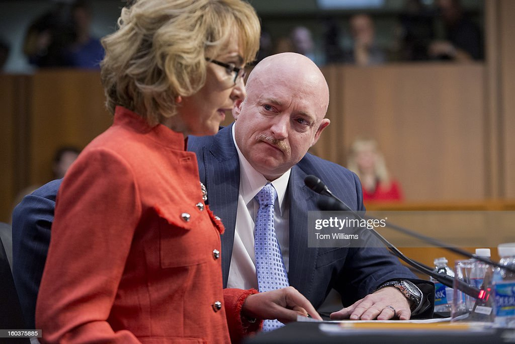 Former Rep. Gabrielle Giffords, D-Ariz., testifies on gun violence as her husband Mark Kelly looks on, during a Senate Judiciary Committee hearing in Hart Building entitled 'What Should America Do About Gun Violence?' Giffords was severely wounded during a mass shooting in Tucson, Ariz., in 2011.