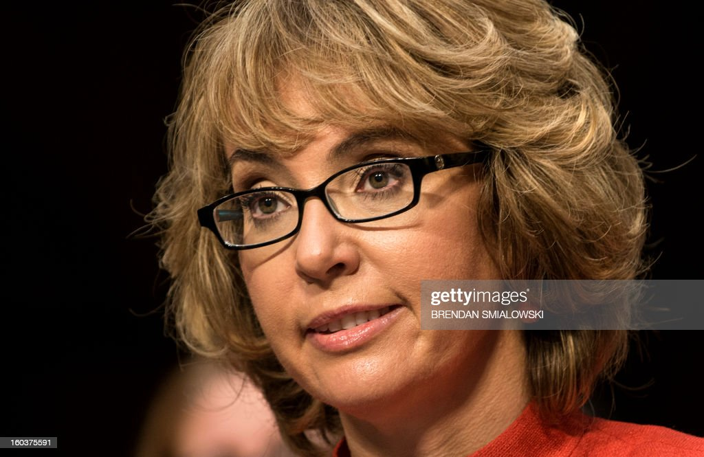Former Rep. Gabrielle Giffords, speaks during a hearing of the Senate Judiciary Committee on Capitol Hill January 30, 2013 in Washington, DC. The committee held the hearing with retired Astronaut Mark Kelly, husband of former Rep. Gabrielle Giffords, Wayne LaPierre, Chief Executive Officer of the National Rifle Association, and others to testify about solutions to gun violence in the United States. AFP PHOTO/Brendan SMIALOWSKI